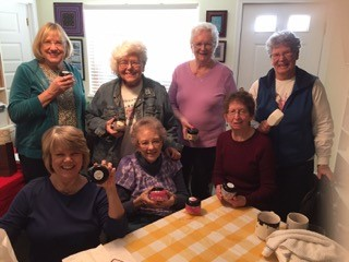 Arts and Crafts group shows off their sugar scrub jars.  front row, l to r: Sue Miller, Darlene Paulsen, Teri McConnell. Back row, l to r: Cornelia Firth, Stephanie Norton, Patsy Webster, and Kris Vasser.